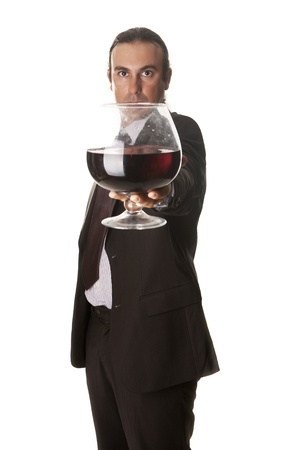 a sommelier with a giant glass of wine Stock Photo