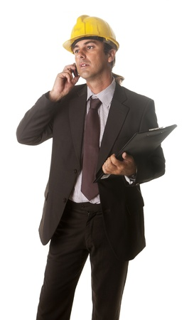 a site manager on the phone explaining the project Stock Photo - 14623058