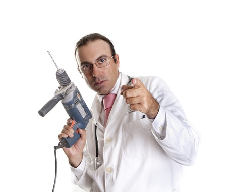 a crazy doctor with a drill Stock Photo - 14623055