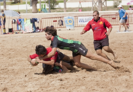 cz: PUERTO REAL, CADIZ - OCTOBER 17: Play Attack of Watermelons green, Against the team of Gibraltar Rugby gray. in the tournament Villa Puerto Real. October 17, 2011 in Puerto Real, C?z (Spain)