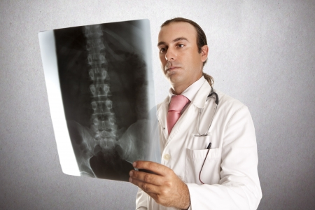 a doctor looking at a radiograph to give their diagnosis