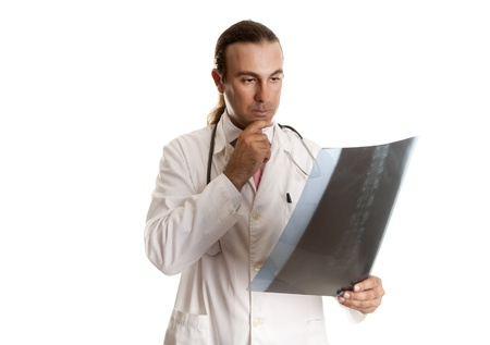 a doctor looking at a radiograph to give their diagnosis Stock Photo - 15037517