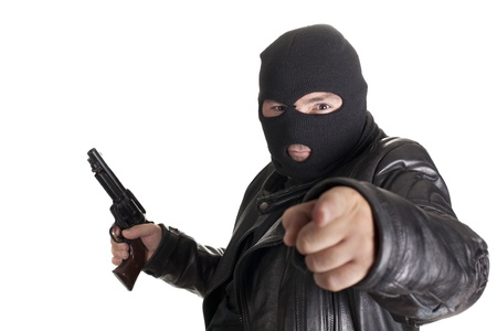 mugger: a mugger with a gun threatening one hand