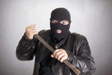 A thief with a crowbar to break into a house Stock Photo - 15236649
