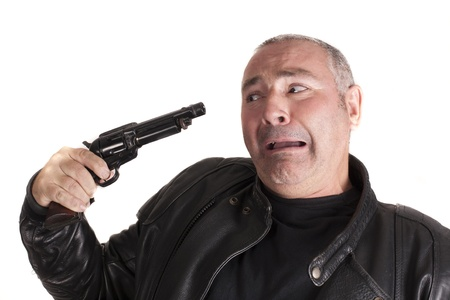 a man with a gun, trying to commit suicide Stock Photo - 15236640
