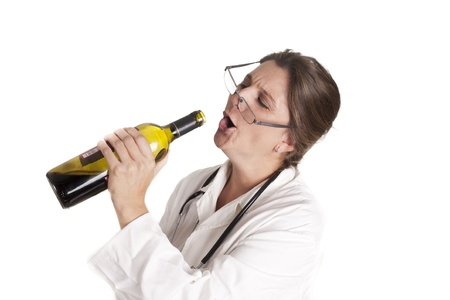 a doctor drunk, drinking from a bottle Banque d'images