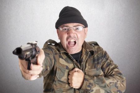 guerrilla: a guerrilla with a gun, shooting