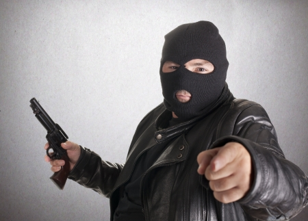 a thief, after docking at gunpoint Stock Photo - 15259725
