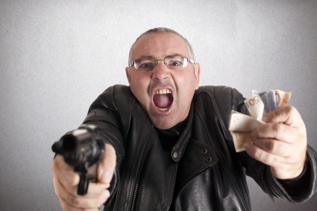 a thief, after docking at gunpoint Stock Photo