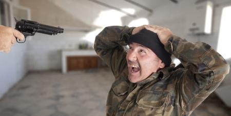 a guerrilla with a gun, shooting photo
