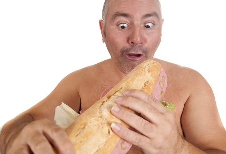 very hungry man in front of a sandwich