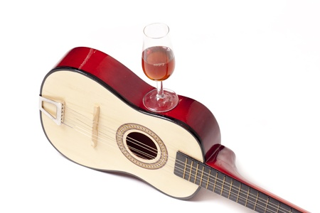 a Spanish guitar, and a glass of wine, two typical symbols of Spain photo