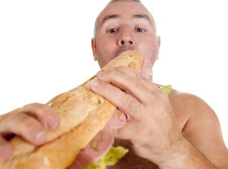 regimen: a man eating a huge sandwich Stock Photo