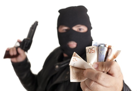 a thief committing a robbery Stock Photo