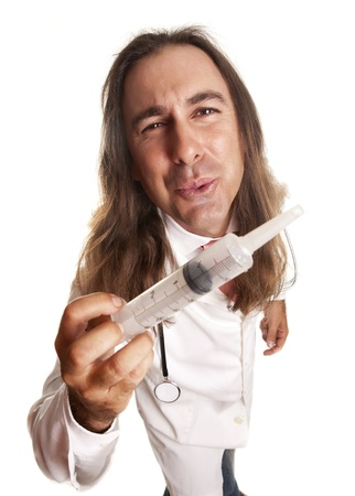 a docor crazy with a huge syringe Stock Photo - 16005266