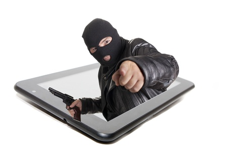 the thief that acts via internet, committing cybercrimes photo