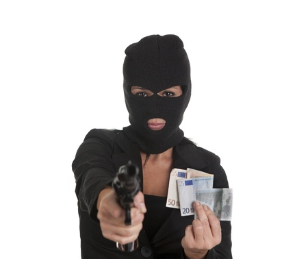 a robber pointing a gun and demanding money photo