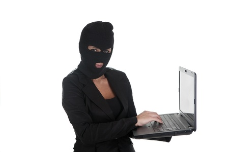 a woman, stealing computer  through photo