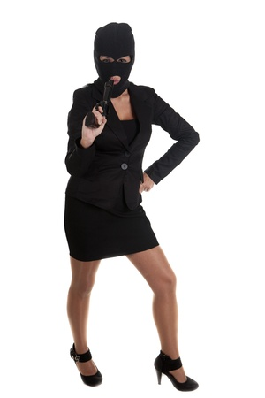 balaclava: a robber pointing his gun, and for silence Stock Photo