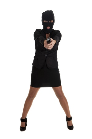 a robber pointing his gun, and for silence Stock Photo - 16407706
