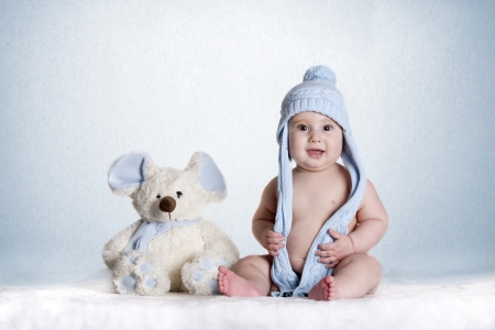 a small baby with his favorite teddy Stock Photo