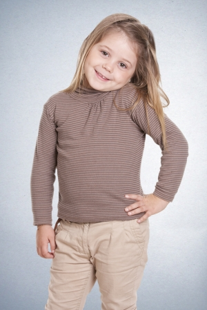 a beautiful girl of 5 years, posing happily