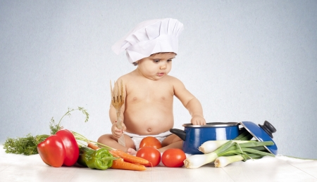a small chef, preparing delicious and healthy food photo