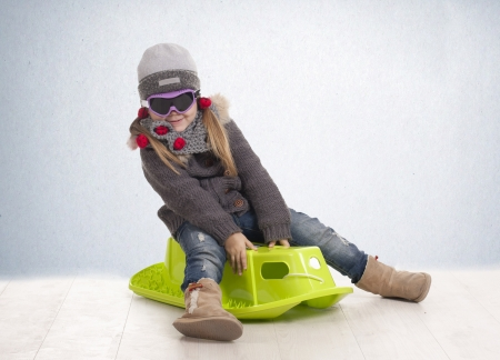 a girl riding on his sleigh photo