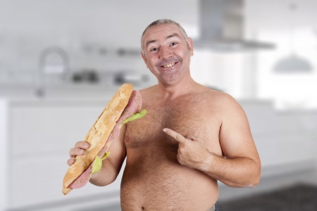a man eating a huge sandwich Stock Photo - 18495552