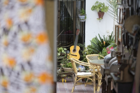 Spanish guitar on a chair, in a typical backyard Stock Photo - 18514955