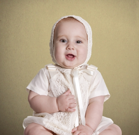a small baby, with her   dress to celebrate her christening Stock Photo - 18495550