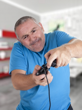 a man playing a game with the console Stock Photo - 18495556