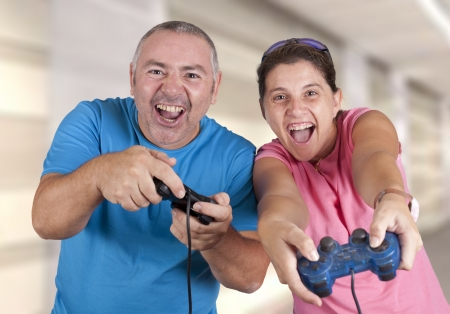 a couple playing a video game Stock Photo - 18495555