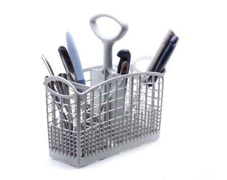 dishwasher basket, with knives, forks and spoons to be washed Stock Photo