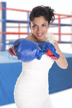 a bride with boxing gloves as a sign of struggle photo