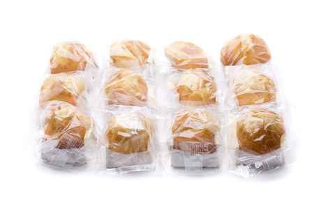 several industrially packaged muffins, to be sold