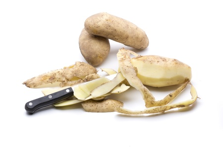 cutting a potato, to prepare it to be cooked