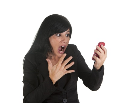 a businesswoman, screaming on the phone to their employees photo