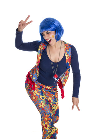 hippy girl with her colorful costume dancing Stock Photo