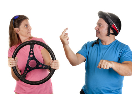two people, pretending to drive a car and a motorcycle photo