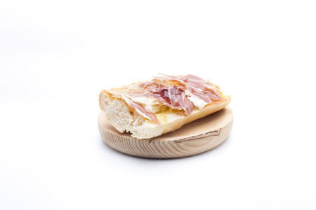 a slice of bread with oil and ham, typical Spanish breakfast Stock Photo