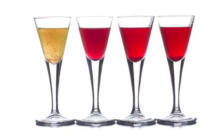 several shot glasses with different drinks, which combined represent the flag of a country Stock fotó