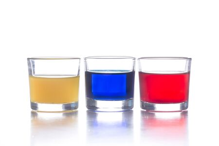 several shot glasses with different drinks, which combined represent the flag of a country