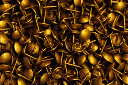 studs: close up of a lot of golden studs