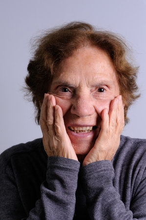 human's arm: close up of a smiling elderly woman, surprised