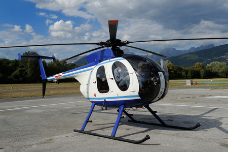 breda: Helicopter parked on an airport runway