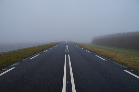 almere: Foggy Road - Oostvaardersdijk, Almere, Flevoland Stock Photo