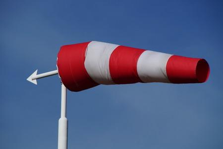 wind vane: Red and white windsock - wind vane Stock Photo
