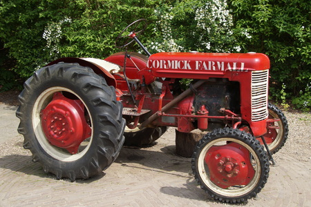 mechanization: Old vintage Agriculture Red Tractor MC Cormick Farmall Editorial