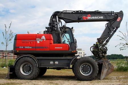 earthmover: Doosan DX140W Excavator or earthmover mechanical digger